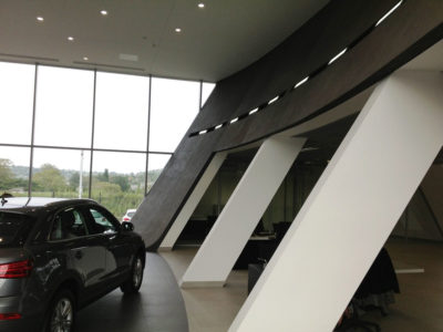 audi centre shospec project-curved-walls-bulkheads-light-steel-frame-building-skimmed-ceilings-metal-pan-ceilings
