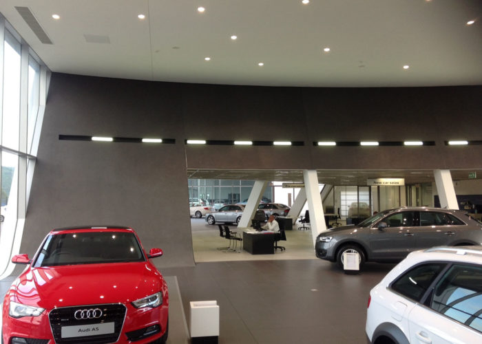 audi centre shospec project-light-steel-frame-building-curved-walls-bulkheads-skimmed-ceilings-east-london