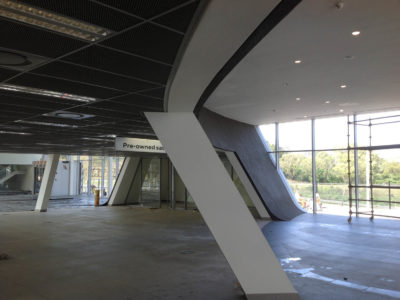 audi centre shospec project light-steel-frame-building-interior-curved-walls-bulkheads-anodised-aluminium-pietermaritzburg